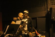 Eteinne Charles hugs his long-standing sideman, Guadeloupean saxophonist Jacques Schwarz-Bart. Etienne Charles live at The Little Carib Theatre, Trinidad. Photo by OvertimeTT.com