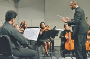 Musical director of the National Philharmonic Orchestra, Dr Roger Henry, conducts his orchestra members during their performance of a series of musical pieces from Joseph Haydn's repertoire at the National Academy of Performing Arts, Port-of-Spain. PHOTO: MARYANN AUGUSTE. Courtesy Trinidad and Tobago Guardian.