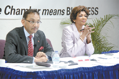 Vasant Bharath with TT Chamber CEO Catherine Kumar. Photo courtesy T&T Guardian.