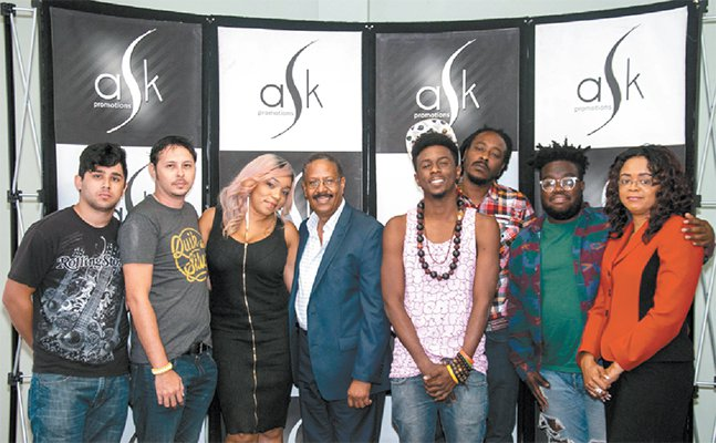 Members of the contingent for SXSWin Austin, Texas, next month with ASK Promotions CEOStephen Howard, fourth from left, and ASKchief operating officer Charlene Belfon, right. PHOTO:CassStuart. Courtesy T&T Guardian